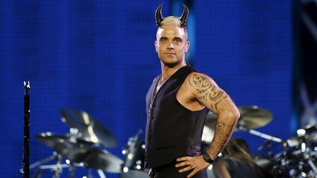 Robbie Williams Tawarkan Diri Wakili - Jakarta CNN Indonesia Penyanyi Inggris Robbie Williams menawarkan diri bersedia mewakili Rusia dalam kontes menyanyi antar negara Williams